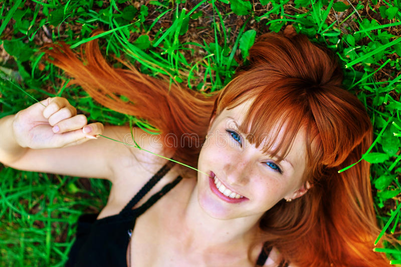 Portrait of the young girl on a lawn royalty free stock photo
