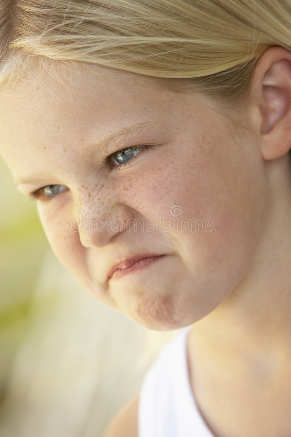 Portrait Of Young Girl Looking Angry royalty free stock photography