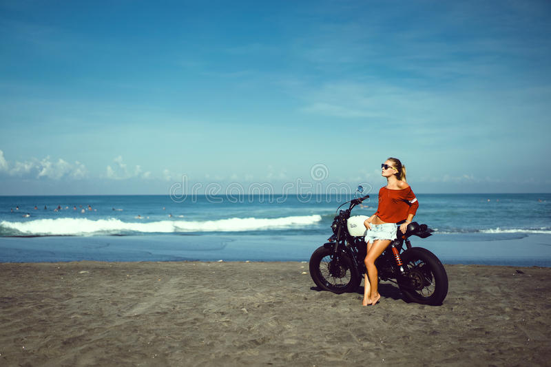 Portrait young girl on motorbike stock photography