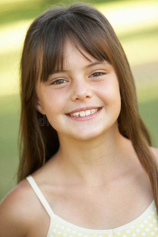 Portrait Of Young Girl In Park stock photo