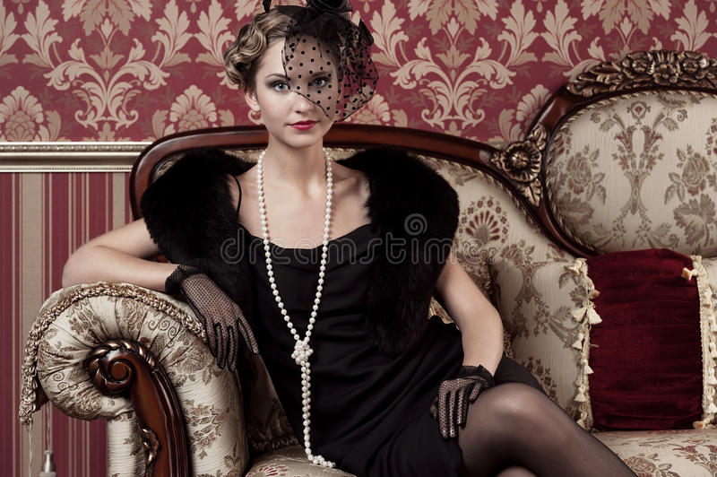Portrait of a young girl in retro style royalty free stock photos
