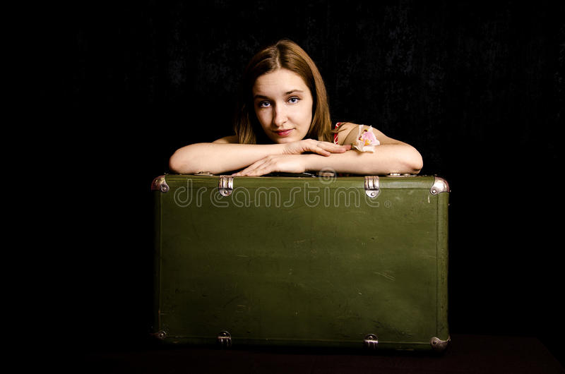 Portrait of a young girl with a suitcase stock photos