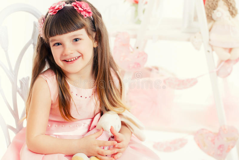 Download Portrait Of Young Girl With A Toy In The Hands Of Stock Photo - Image: 38780138