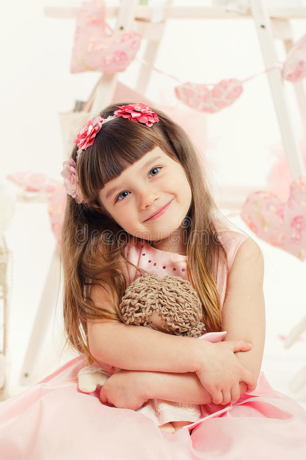 Download Portrait Of Young Girl With A Toy In The Hands Of Stock Photo - Image of cheerful, innocence: 38783502