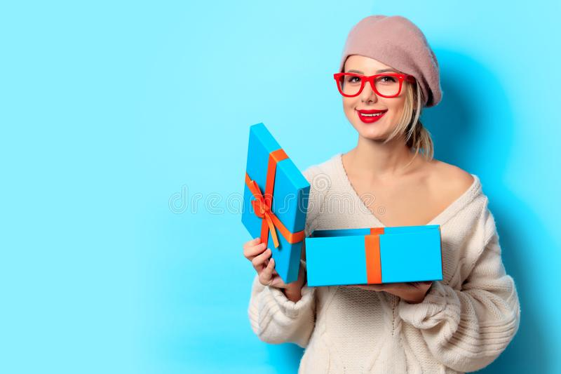 Girl in white sweater with gift box royalty free stock images
