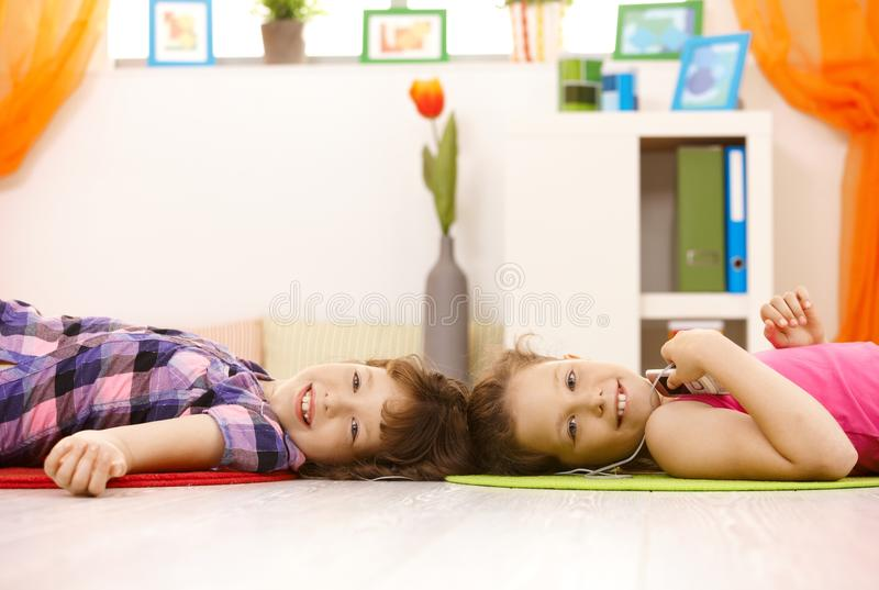 Portrait Of Young Girls Enjoying Music Royalty Free Stock Photography