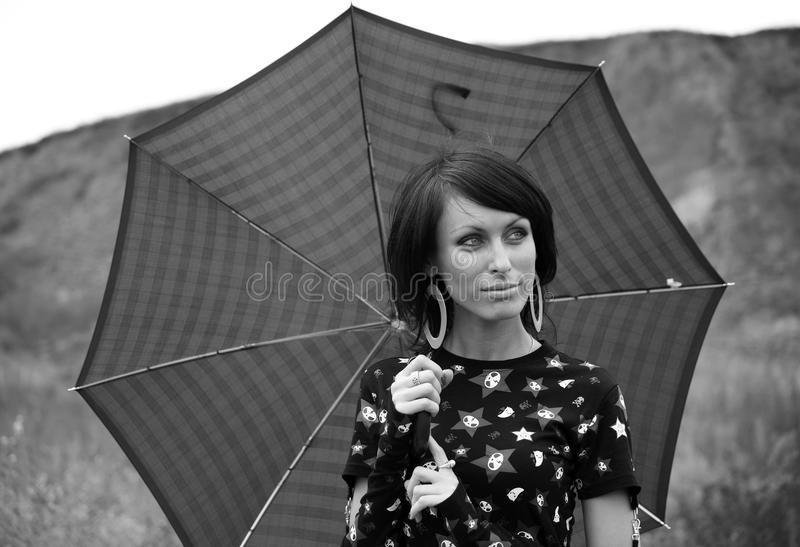 Portrait of a young glamour girl with umbrella, royalty free stock image