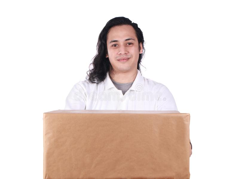 Courier Delivery Man Giving Box. Portrait of young good looking Asian courier delivery man giving box of parcel package, looking at camera amd smiling, isolated stock photo