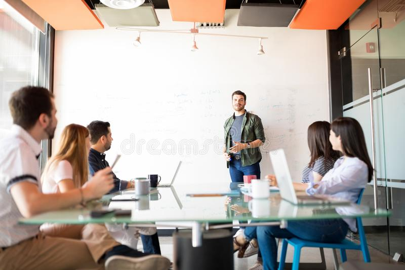 Man giving a business presentation to his colleagues stock photography