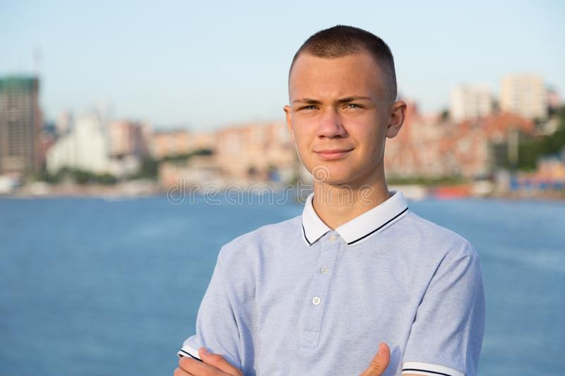 Portrait of a young guy on the background of the city stock image