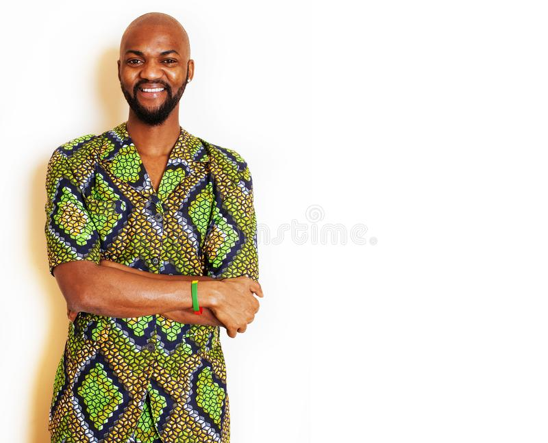 Portrait of young handsome african man wearing bright green national costume smiling gesturing, entertainment stuff royalty free stock photos