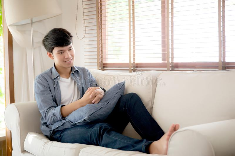 Portrait young handsome asian man napping relax with cozy on sofa at home royalty free stock photo