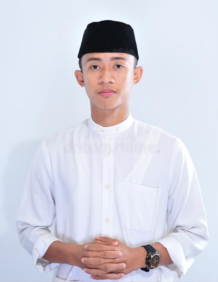 Portrait of young handsome Asian muslim man stock image