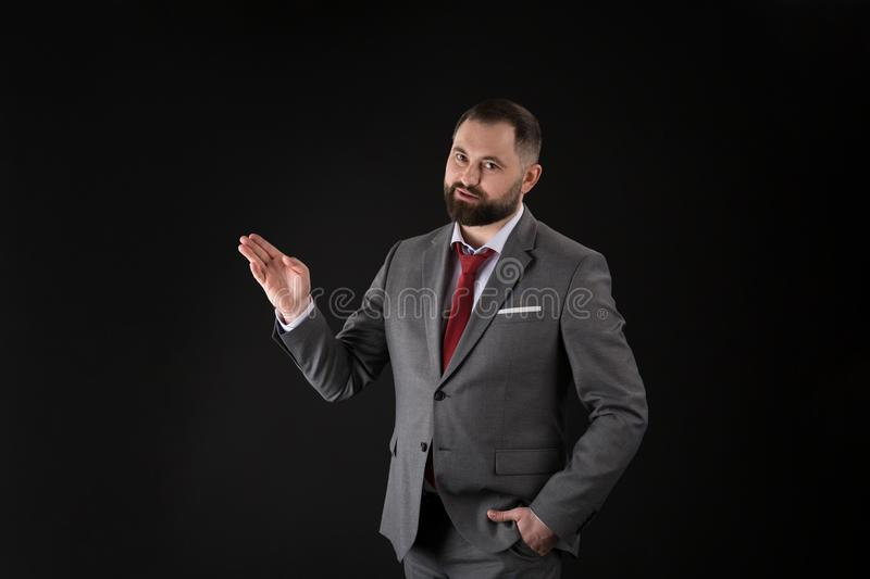 Portrait of young handsome business man presenting gesture on black background royalty free stock photography
