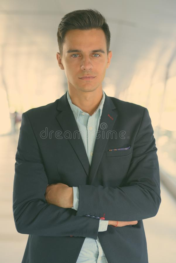 Portrait of young handsome businessman exploring the city stock images