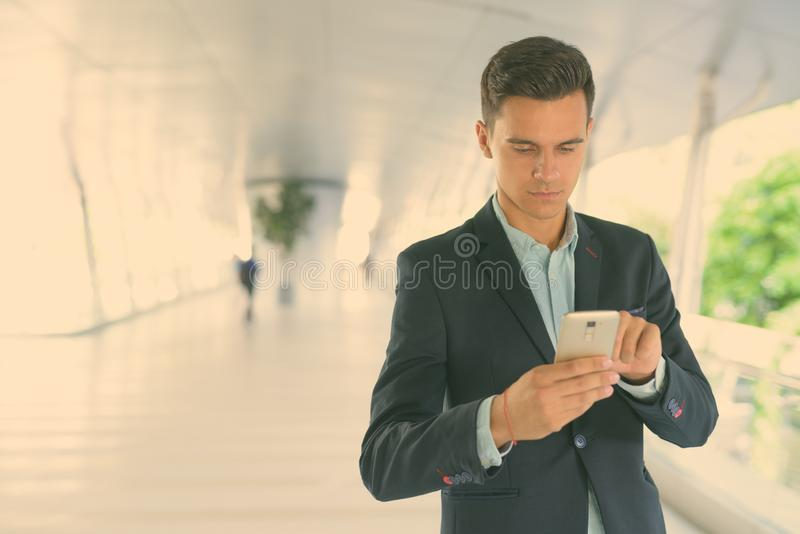 Portrait of young handsome businessman exploring the city stock photography