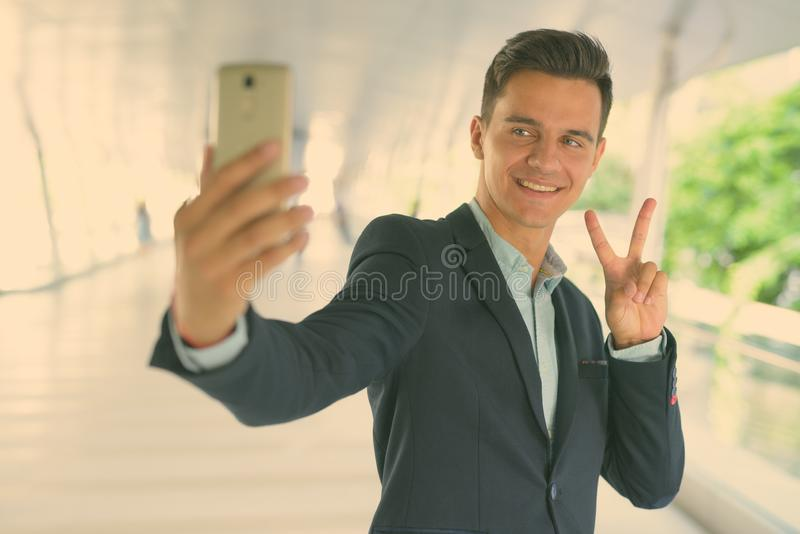 Portrait of young handsome businessman exploring the city stock photos