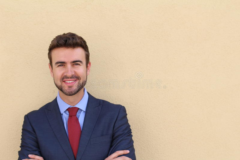 Portrait of a young handsome businessman smiling royalty free stock photography