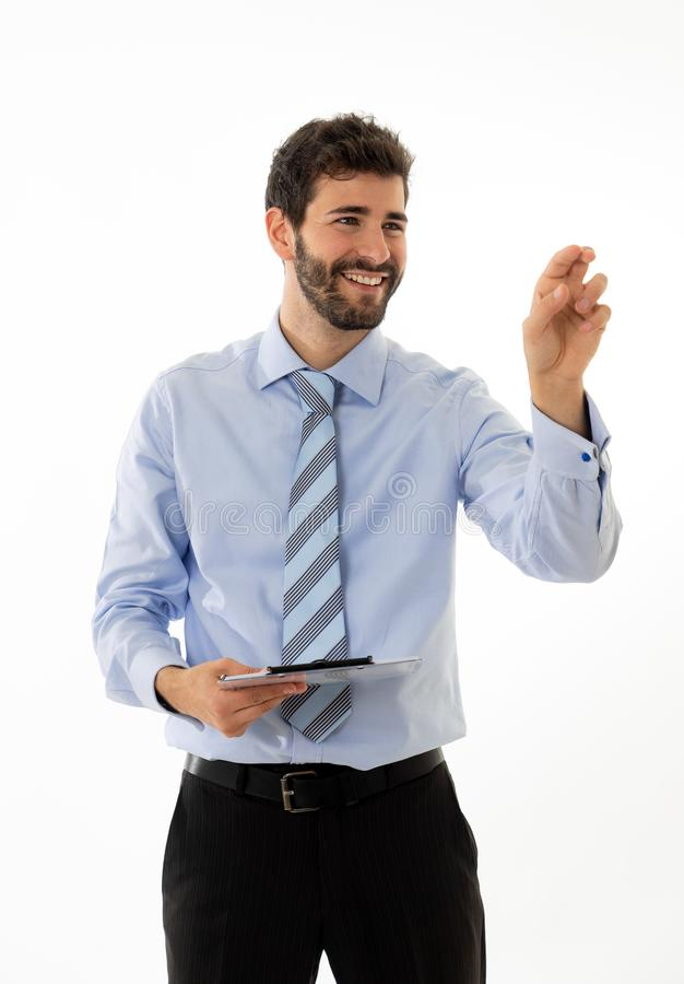 Portrait of a young handsome and confident businessman pointing as touching virtual screen stock photography