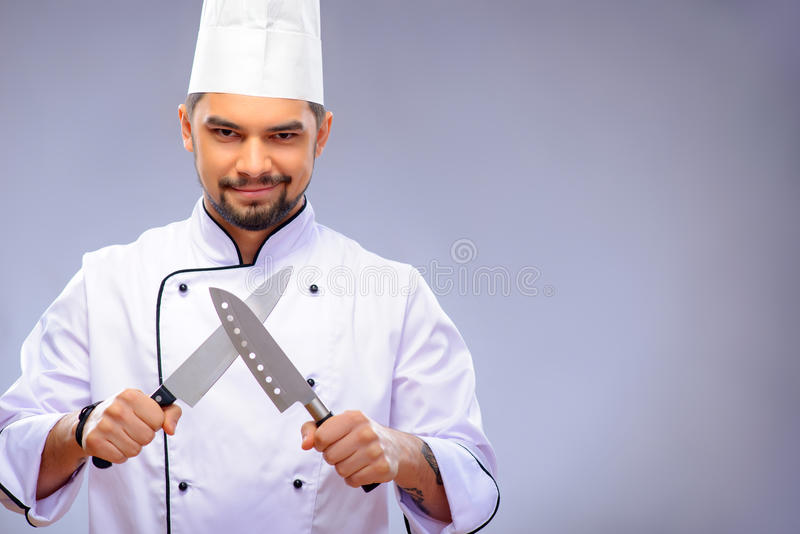 Portrait of young handsome cook royalty free stock photography