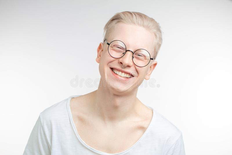 Portrait of a handsome young man, over a gray background royalty free stock photography