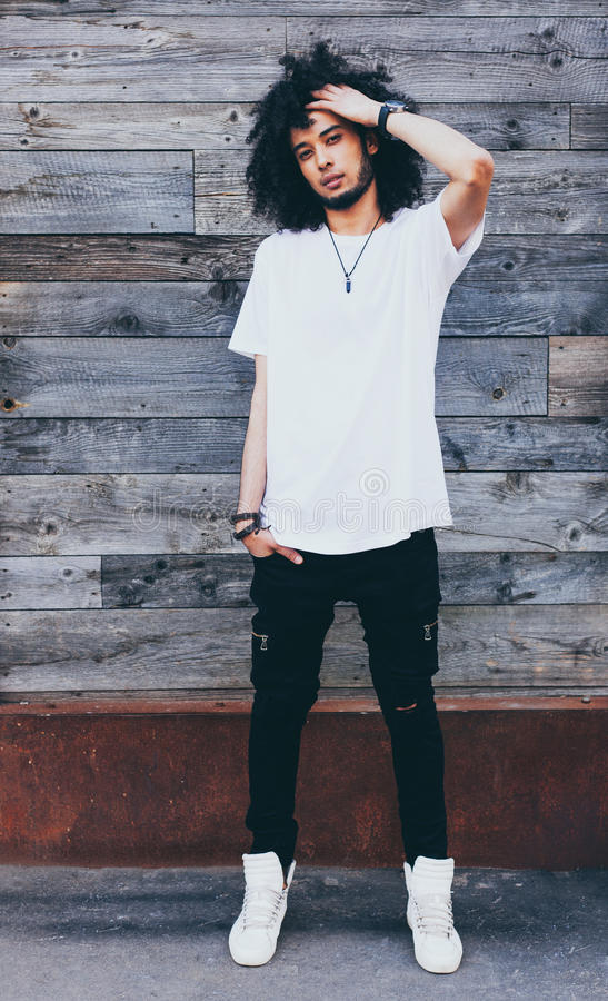 Portrait young handsome fashion bearded afro hair model black man in urban. Rest and relax. Dressed in a white t-shirt stock photos