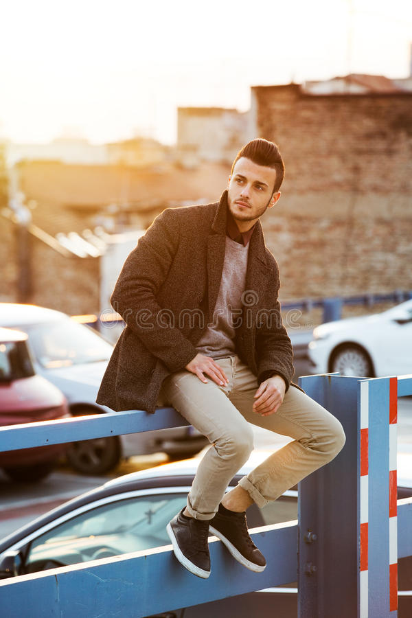 Portrait of young handsome fashionable man stock photo