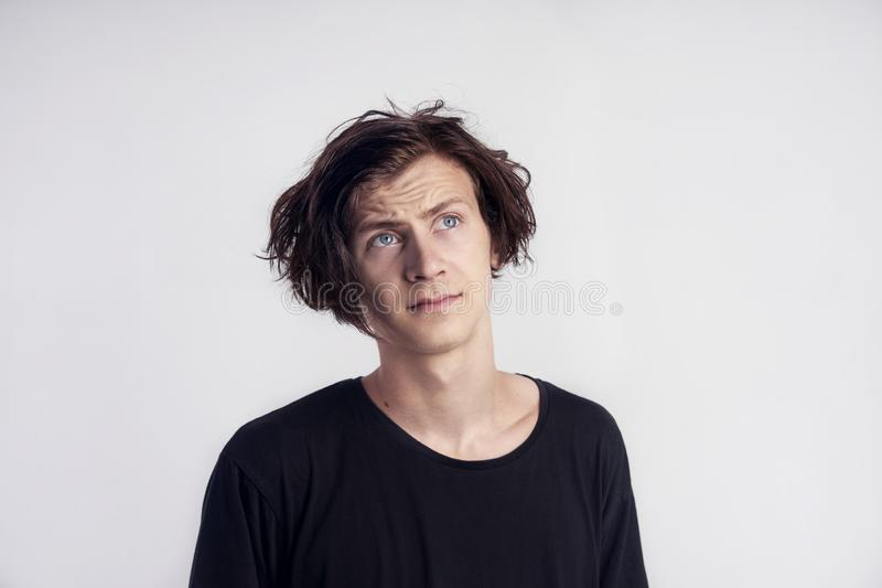 Portrait of young handsome hipster man look surprised disappointment, black t-shirt, white background stock photography