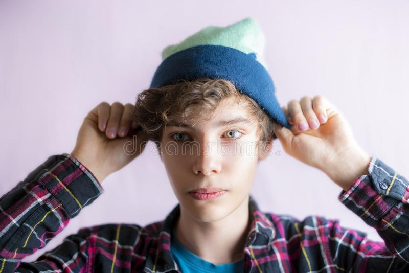 Portrait of young handsome male put on and wear hat isolated f royalty free stock photography