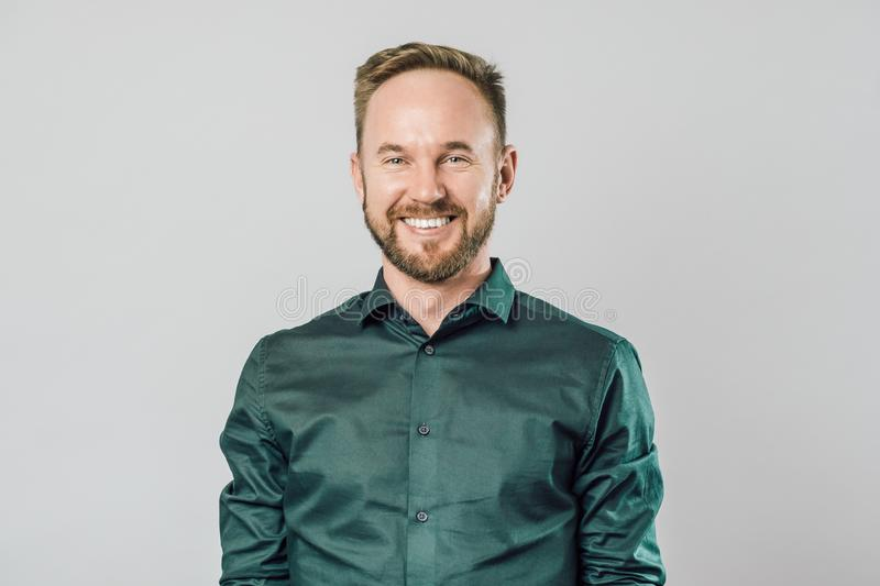 Portrait of young handsome man with beard smiling laughing stock images