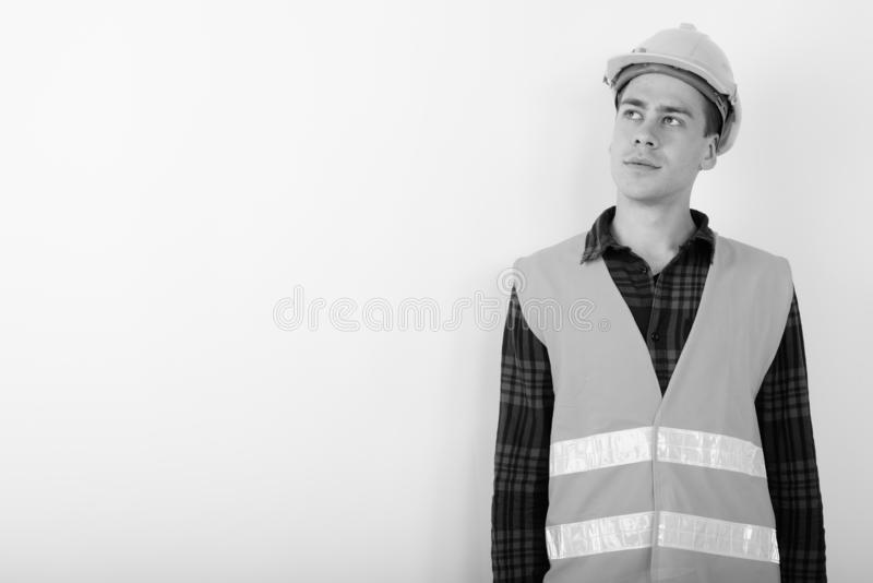 Portrait of young handsome man construction worker in black and white stock photos