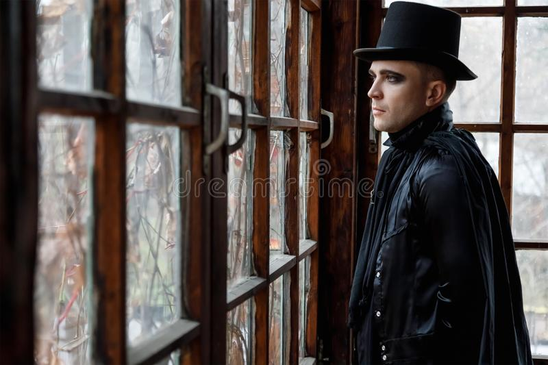 Portrait of a young man in old fashioned vampire style clothes stock image