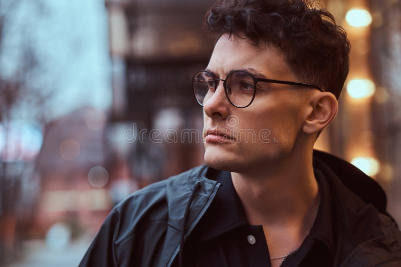 Portrait of a young handsome man outdoors. royalty free stock images