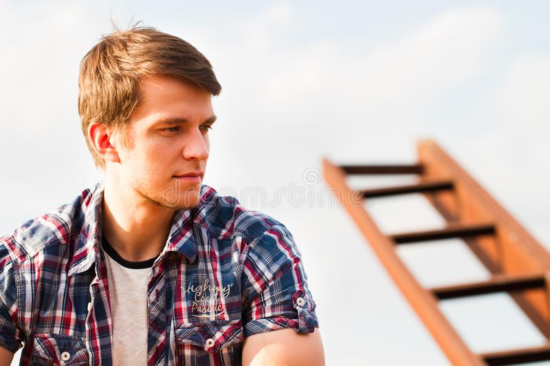 Portrait Of Young Handsome Man Smiling Outdoor stock image