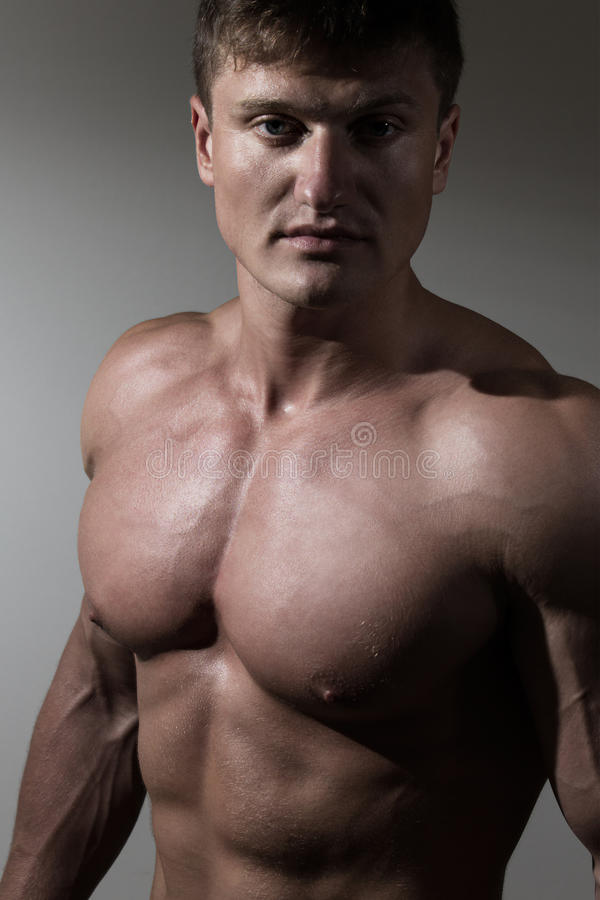 Portrait of young handsome naked man stock images