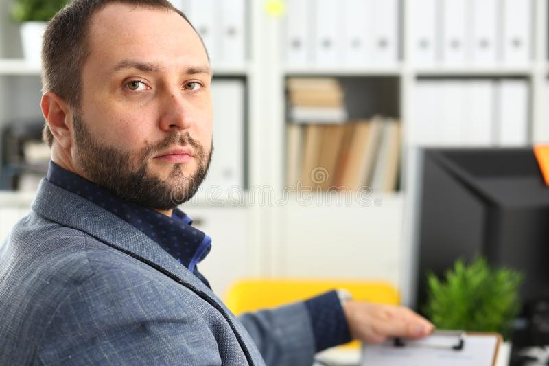 Portrait of young handsome promising businessman in office. Portrait of young handsome promising businessman work in office like his job royalty free stock images