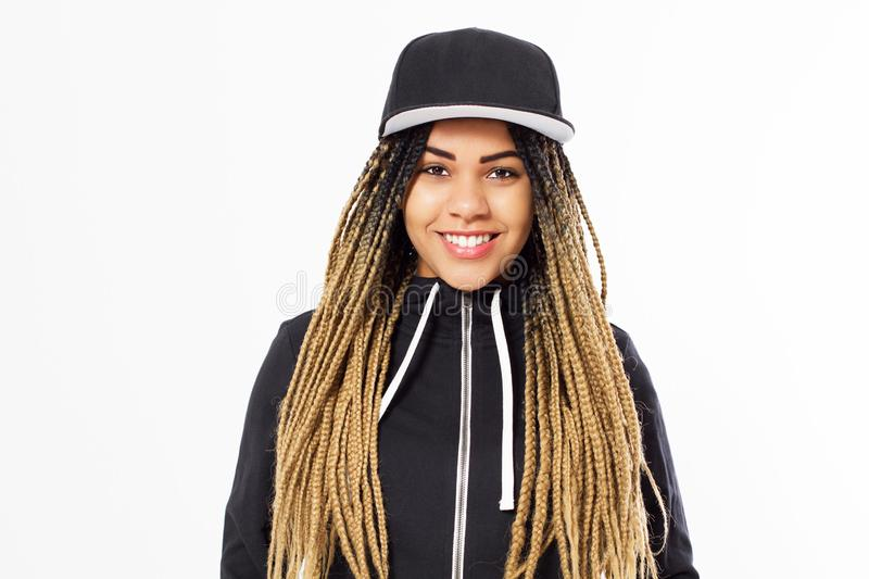 Portrait young happy afro american woman with dreadlocks hair and blank cap in hoodie - mockup royalty free stock images
