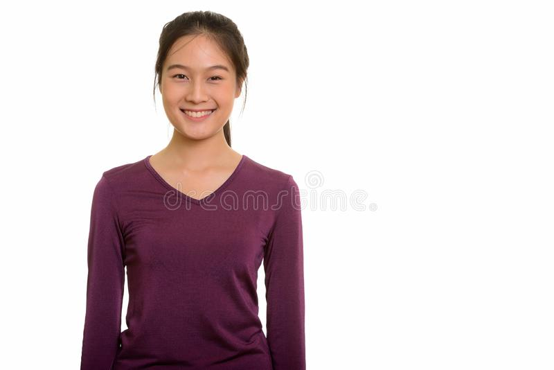 Portrait of young happy Asian teenage girl smiling stock photo