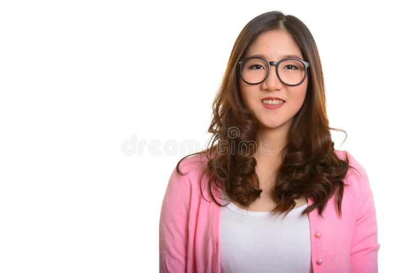 Portrait of young happy Asian woman smiling isolated against white background stock photography
