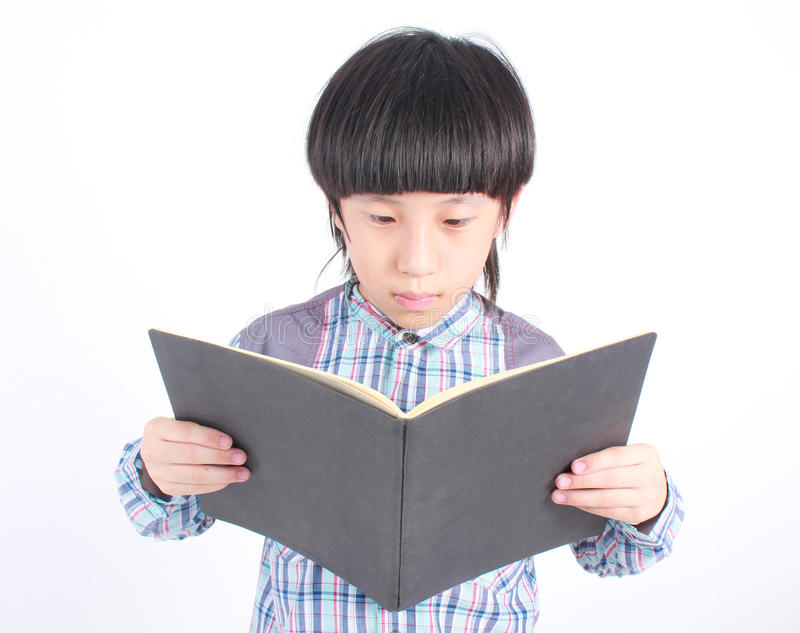 Portrait of young happy boy with book royalty free stock image