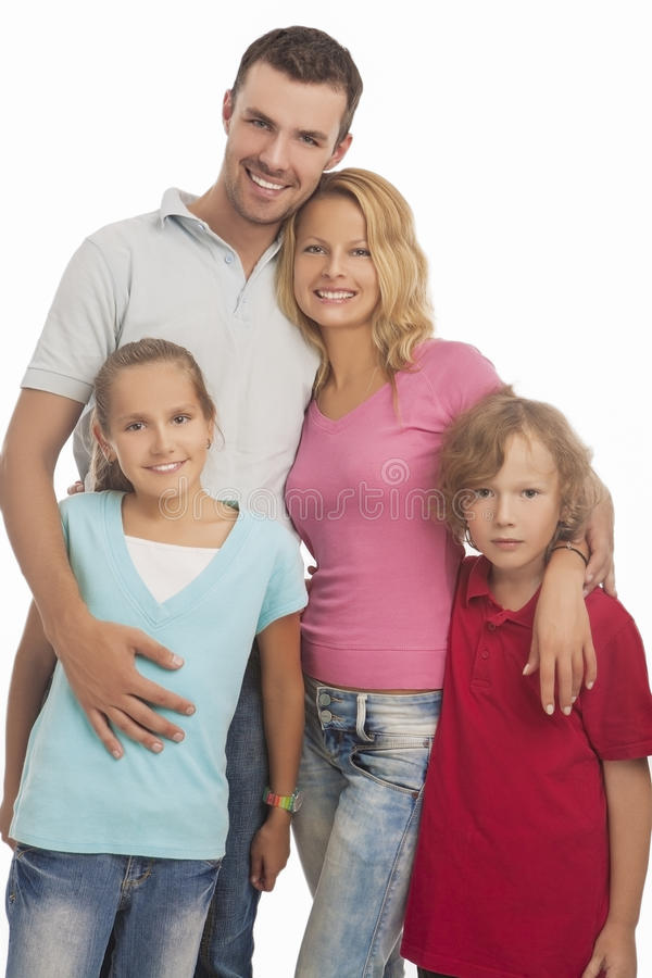 Portrait Of Young Happy Caucasian Family Standing Together With Royalty Free Stock Photo