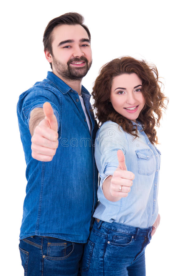 Portrait of young happy couple thumbs up isolated on white stock photos