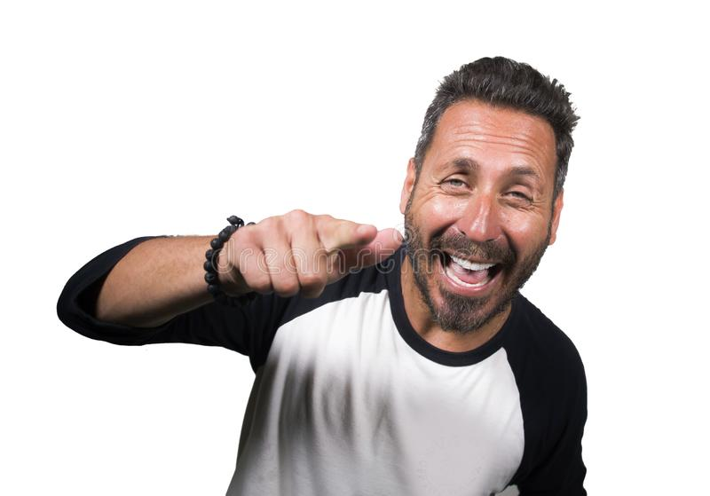 Portrait of young happy and positive attractive 40s man with blue eyes and beard smiling happy and cheerful. Wearing casual sporty tshirt isolated on white royalty free stock images