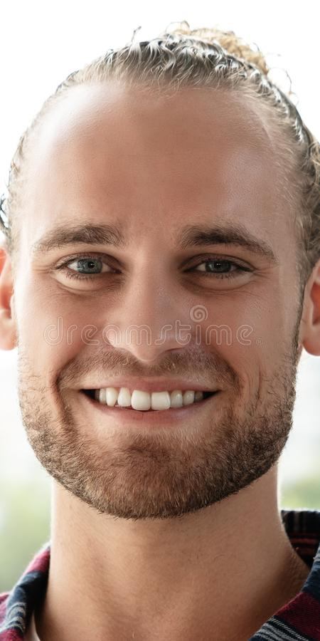 Portrait of young happy short stylish bearded caucasian man or creative designer smiling and looking at camera. Feeling confident in casual outfit. Headshot of royalty free stock images