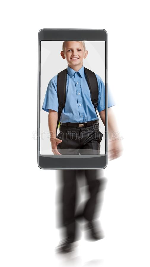 Young schoolboy with knapsack. Portrait of young happy smiling blond schoolboy with knapsack. conceptual image with a smartphone, demonstration of device royalty free stock image