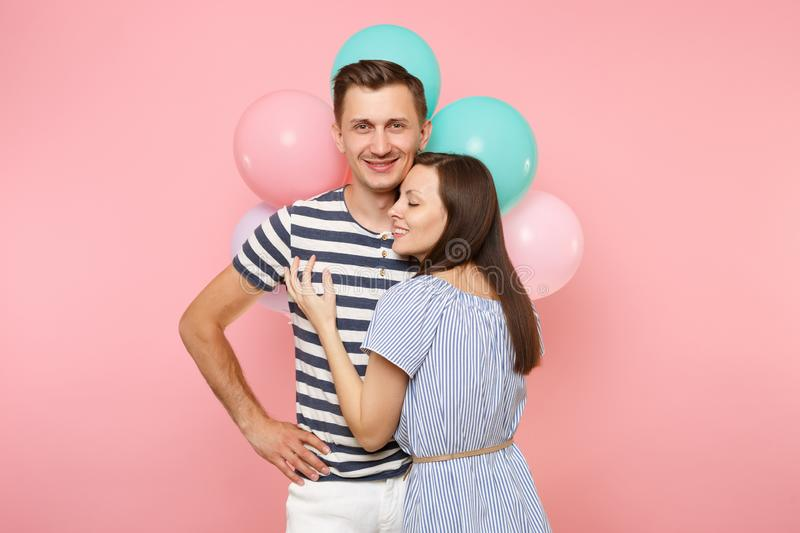 Portrait of young happy embracing couple in love. Woman lean on one`s man chest celebrating birthday holiday party on royalty free stock image