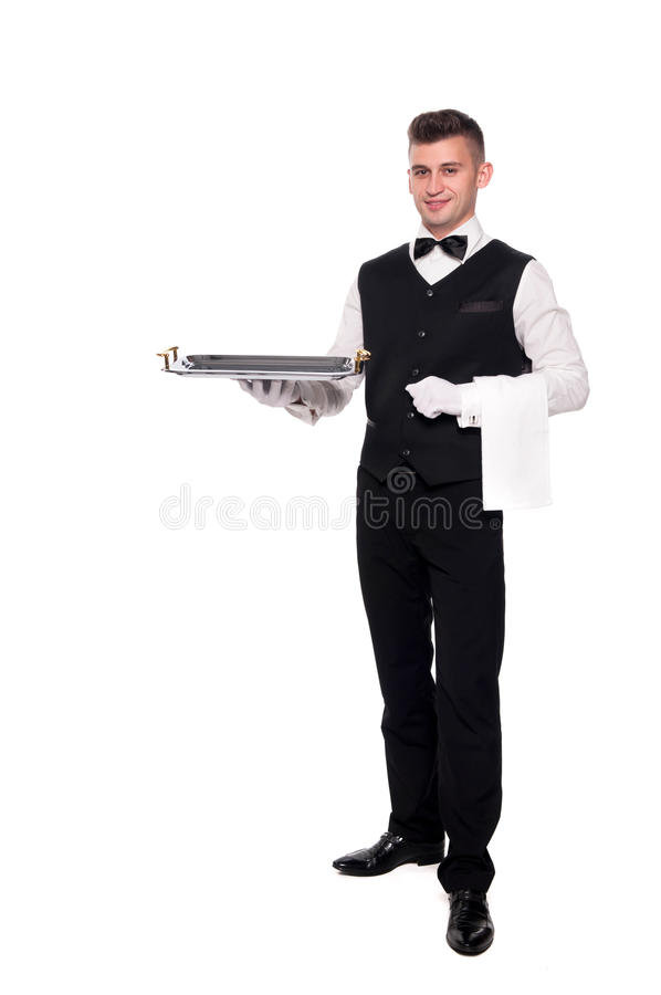 Portrait of young happy smiling waiter with on tray isolated on royalty free stock photo