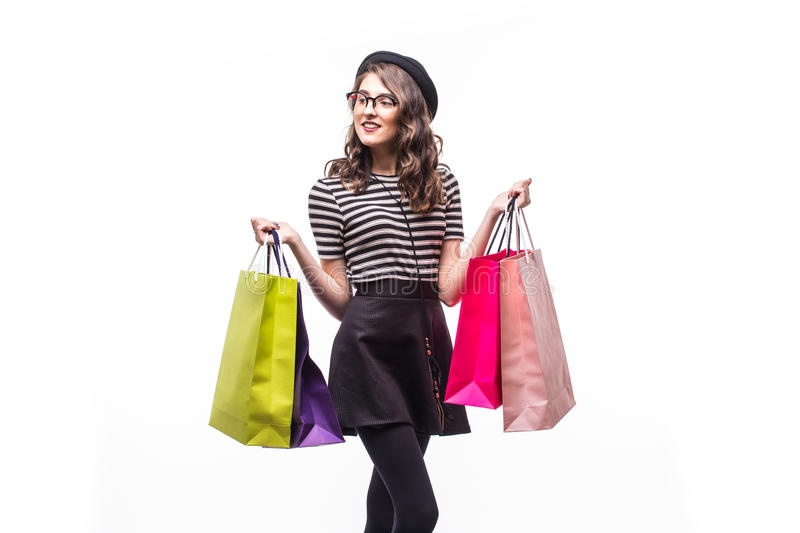Portrait of young happy smiling woman with shopping bags isolated over white background stock photos
