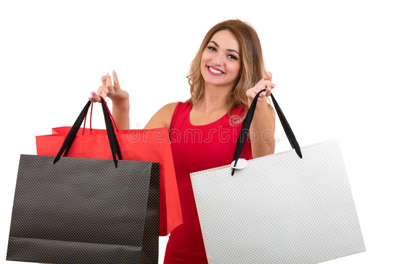 Portrait of young happy smiling woman with shopping bags, isolated over white background stock photo