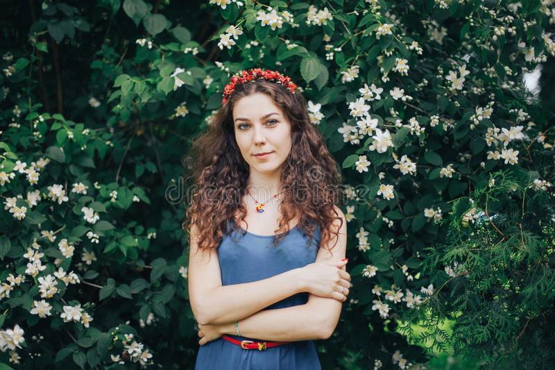 Portrait young happy woman in an apple orchard royalty free stock image